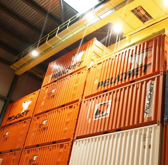 Stacked Pelichet containers in a warehouse.
