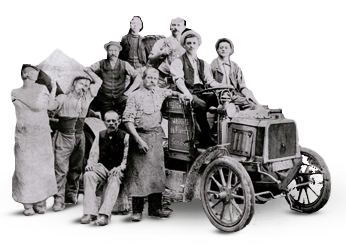 Historic black and white photo of people with vintage transport truck.