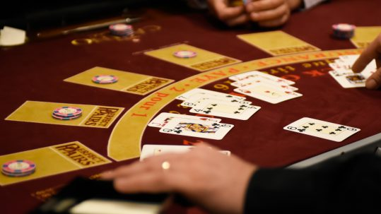 Poker table with chips and cards in play.