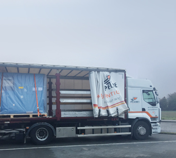 Pelichet truck transporting equipment.